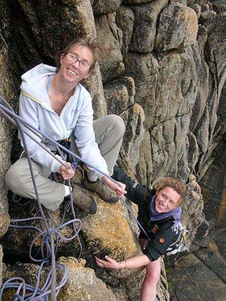 two women climbing in the peak district with wilderness weekends